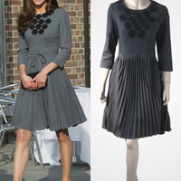 Gray pleated dress with half sleeves and black floral applications inspired by Kate Middleton