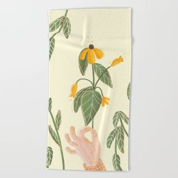 Flower in a hand Beach Towel by chotnelle