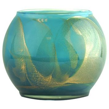 TURQUOISE CANDLE GLOBE by Turquoise Candle Globe THE INSIDE OF THIS 4 in POLISHED GLOBE IS PAINTED WITH WAX TO CREATE SWIRLS OF GOLD AND RICH HUES AND COMES IN A SATIN COVERED GIFT BOX. CANDLE IS FILLED WITH A TRANSLUCENT WAX AND SCENTED WITH MYSTERIA. BU