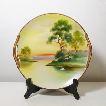 Nippon Hand Painted Plate with Ornate Handles Sunrise Sunset Lake Trees Swan Cottage Barn Scene Antique No chips, cracks or repairs