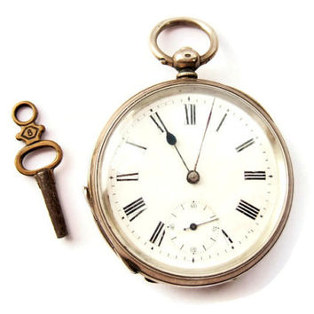 Antique Swiss silver key wind pocket watch, GK maker's mark on case. Not currently working - stopped working after three hours - overwound?