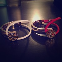 Pair of Tory Burch look a like bracelets