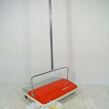 Vintage Bissell Capri Carpet Sweeper – Groovy Mid Century Orange Manual Vacuum Cleaner - Retro Rug Push Broom with Self Cleaning Brush & Bin