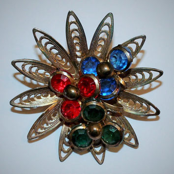 Vintage Mod Retro Gold Metal Star burst Brooch with colorful plastic accent stones