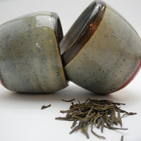 Chinese tea cups, small ceramic drinking beakers in gray and red