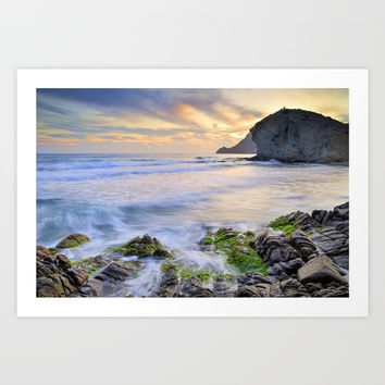 lonely sunset at the sea Art Print by Guido Montañés