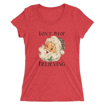 Don't Stop Believing Tri-Blend Super-Soft Form-Fitting Ladies' short sleeve t-shirt featuring vintage Santa leopard print hat