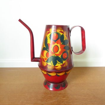 Red toleware pitcher signed Geo Burton, decorative folk art from 1970s