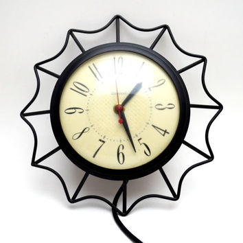 Vintage United Wall Clock, Mid Century Black Metal Starburst Clock, Model 69, circa 1950s-1960s