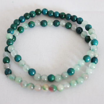 A set of 2 cascading color mini green jade stone beads bracelet
