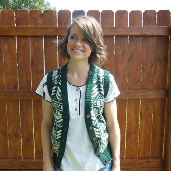 Vintage 1960's button up sweater vest.  Hunter green with cream colored floral pattern.