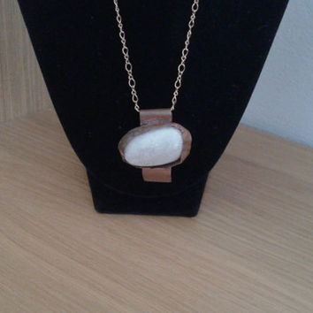 handmade pendant of irregular white rough  stone  copper wrapped