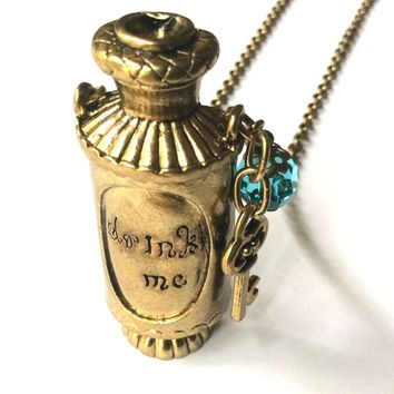 Alice in Wonderland: Drink Me Potion necklace, magic liquid bottle pendant and key charm accented with blue crystal