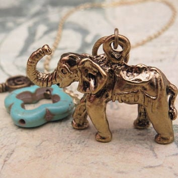 Elephant necklace with turquoise clover and key accent