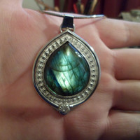 Authentic Navajo Native American Southwestern sterling silver labradorite pendant/necklace.berry or flower wire.
