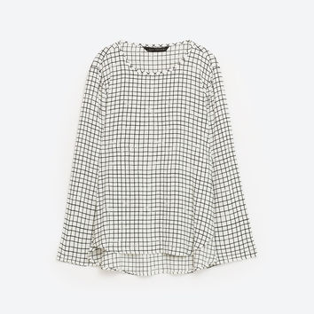 CHECKED BLOUSE DETAILS