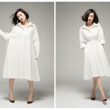 women shirt dress in white,long sleeve,oversize,loose fit,pleated at waist,made of cotton,knee length,for summer and spring.
