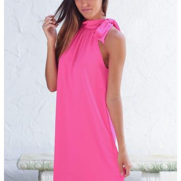 Elegant neon pink halter dress with neck bow detail | Cricket | escloset.com