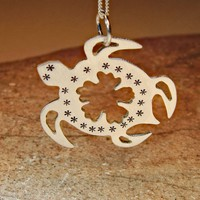 Sea turtle pendant in sterling silver with hibiscus flower