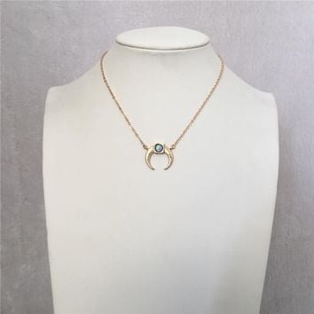 LOVELY GOLD COLOR HORN WITH IRIDESCENCE SKYBLUE STONE PENDANT NECKLACE