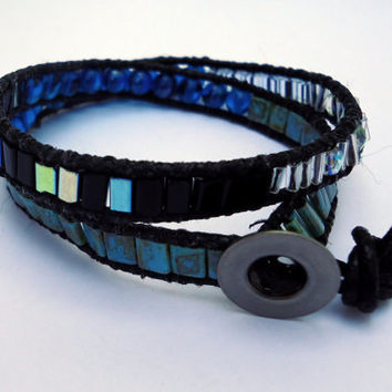 Double wrap bracelet in black leather with picasso tila beads,bugle beads,fire mountain gems,and glass beads.