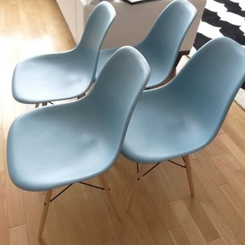 4 HERMAN MILLER EAMES MOLDED PLASTIC SIDE CHAIRS
