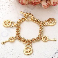 DCCKJ1A MK Michael Kors Stylish Ladies Men Letter Small Lock With Key Accessories Couple Bracelet