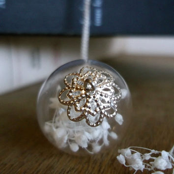 Baby breath bouquet in a hand-blown glass bead pendant