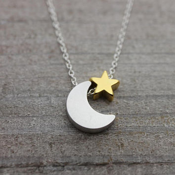 Silver crescent moon with tiny gold star on silver chain necklace