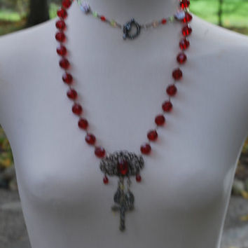 Assemblage Ruby Necklace with ruby glass facuted beads, antique brooch, and vaseline glass beads