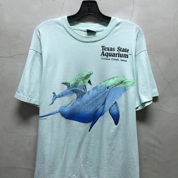 vintage t shirt, dolphins, 90s, Texas State Aquarium, Corpus Christi, Texas, soft, thin shirt, light teal, blue, 50 50, vintage dolphin t