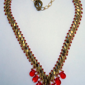 Beaded necklace with swarovski crystals,tila beads,teardrop beads,gold plated chain and antique toggle.
