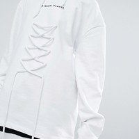 Criminal Damage Oversized Hoodie With Lace Up at asos.com