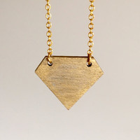 Gold laser cut wood diamond shaped pendant.  Hand painted with gold leaf and attached to a gold plated chain. Simple, modern and OOAK.