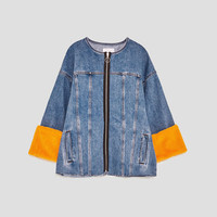 OVERSIZED JACKET WITH REMOVABLE APPLIQUES