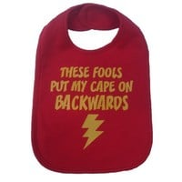 These Villains Put My Cape The Wrong Way Around Superhero Bib Baby Shower Gift - Red