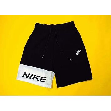 NIKE 2018 summer men and women models spoof yin and yang stitching shorts F-AG-CLWM Black