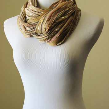 Tan scarf, bright color mix throughout, with bright metallic lurex threads and twisted tassels. Summer lightweight scarf