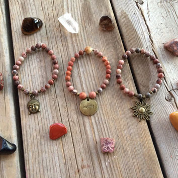 Live by the sun red Picasso, picture, and natural/brown jasper karma Buddha head sun yoga-inspired stacked bracelet set