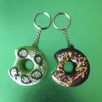 Green and brown chocolate donut squishy keychain two pack in green, chocolate brown sauce and brown chocolate multicolored sprinkles
