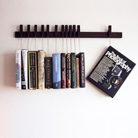 Custom made wooden book rack in Wenge.