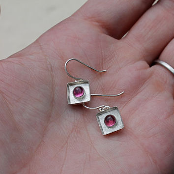 Pink Tourmaline Sterling Silver Bezel Set Shadow Box Earrings. Small frame. Pink Stone. Bright. textured background. tourmaline