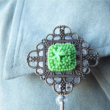 Badge Reel: Green Flower Resin Cabochon on Brass Filigree