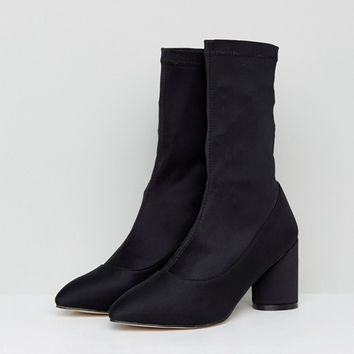 RAID Darcie Black Heeled Sock Boots at asos.com