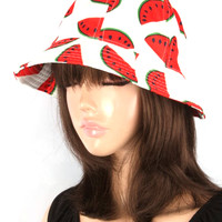 Enjoy the sun with this delightfully appropriate bucket hat featuring everyone favorite summertime treat, the watermelon print throughout.