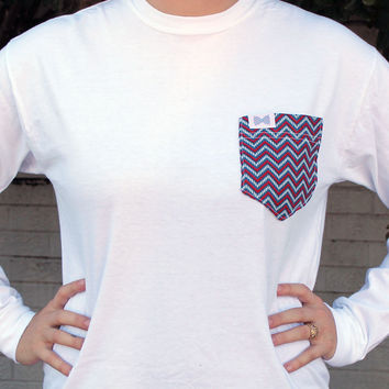 The Shelly Unisex Long Sleeve Tee Shirt in White with Blue/Red Chevron Pocket by the Frat Collection