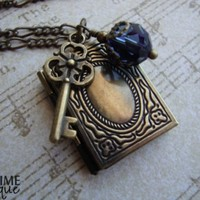 SECRETS - Locket necklace with brass book, skeleton key charm and swa | JetaimeBoutique - Jewelry on ArtFire