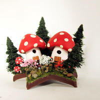 Tiny Mushroom Fairy Houses Upon a Star - Miniature Spotted Red Cap Woodland Houses with Pine Trees and Flowering Bushes