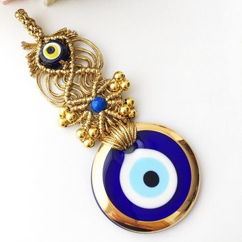 Blue evil eye wall hanging | gold macrame evil eye | gold evil eye charm | evil eye decor