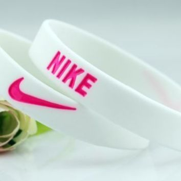 Nike silicone wristband white pink bracelet breast cancer awareness WEAR PINK